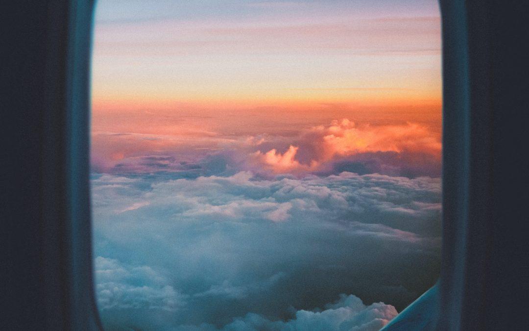 plane window overlooking sea of clouds
