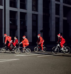 group of people wearing Santa costume riding bikes